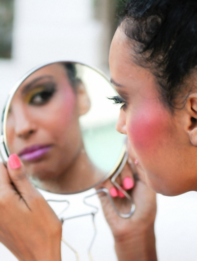 young-african-american-woman-looking-in-mirror